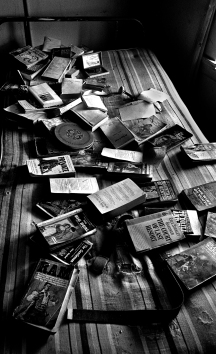 This particular room was absent of empty wine bottles. There were many other paperbacks and other reading materials on the floor.