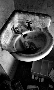 Not all the hotel rooms had sinks. At night, many used the sinks as a urinal. There were an unknown number of sinks without running water. This one did not work for sure. You could tell because the drain was totally clogged with cigarette butts and ashes.