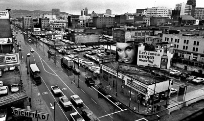 View of Howard Street from the Yerba Buena Hotel at Howard and 3rd Streets. This area was referred to as Skid Row since the 1930s. In the 1970s, the City of San Francisco redeveloped the area with the Yerba Buena Redevelopment project. You are looking at the heart of Skid Row.