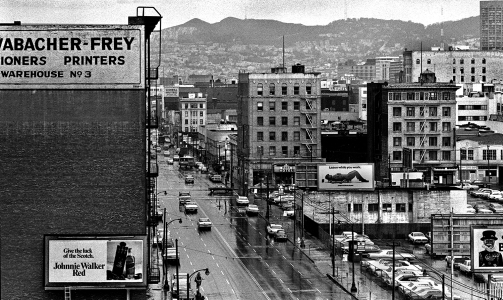 This is a telephoto shot of Howard Street from the Yerba Buena Hotel on Howard and 3rd St. In the picture center is the Mars Hotel on 4th and Howard. Howard Street, between 3rd and 4th Streets, was considered the center of Skid Row.