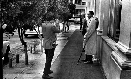 """Often, I would wear a coat and tie when shooting pictures on Skid Row. I did not want to dress down and try to """"melt"""" in; or try to hide my cameras. That would be dishonest. I wanted to make it clear to all that I was an outsider and was there to take their pictures."""