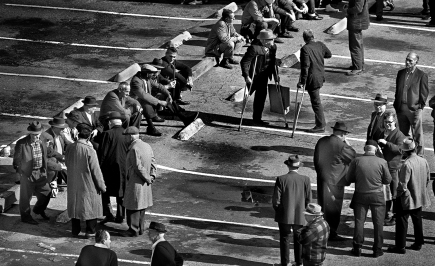 This parking lot on 4th and Howard Streets served as a Skid Row social gathering spot on weekends if the weather was nice. People would arrive at first light. These gatherings also served as a local trading post.