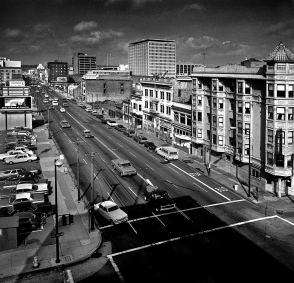 View of Howard Street from the Mars Hotel on 4th and Howard Streets. This area was considered the central area of the Skid Row that dates back to the 1930s. On the right is the Netherlands Hotel.