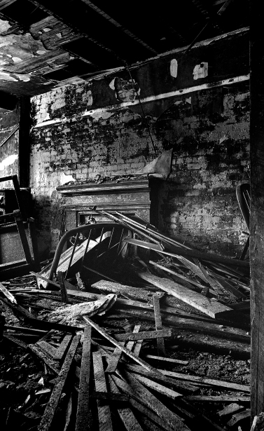 A campfire by homeless people in an abandoned hotel caused this fire damage. The abandoned hotel doors were chain locked but determined persons seeking shelter could always find a way in.
