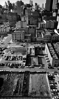 View of Third and Howard Streets from the Pac Tel building at 666 Folsom St. This area is the heart of Skid Row. Demolition of the old buildings was in full stride at this time.