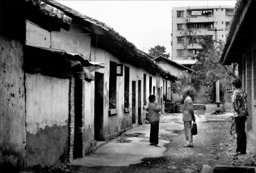 Each doorway in this Beijing alley represents a family home consisting of a single room. In the background is an example of the first generation housing built by the PRC. All this would become rubble after the 1990's when Beijing went skyward. The wife of the famous writer Lu Ling lived here while he was in prison for association with independent writers.