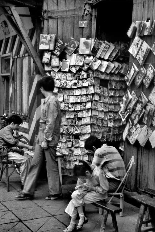 These ubiquitous bookstalls did not sell books. They loaned them for a small fee. They specialized in unrestricted content: such as gory spectacles and far out lurid contents. Their books were printed on cheap paper, wildly illustrated and had very little text. One had to read them on-site with the minder carefully watching.