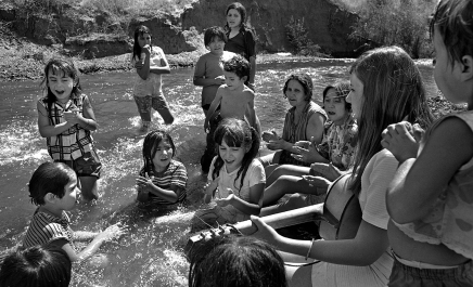 #806-A-23 Migrant Worker Camp, Merced CA 8-10-1970 Salvation Army volunteer tutor with children.