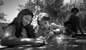 #806-E-12 Migrant Worker Camp, Merced CA 8-10-1970 Salvation Army volunteer tutor with young girl.